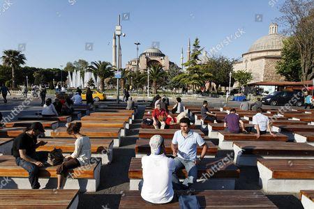 Stock Photo of Hagia Sophia, Aya Sofya, tourists relaxing on benches, Sultanahmet Square, Istanbul, Turkey