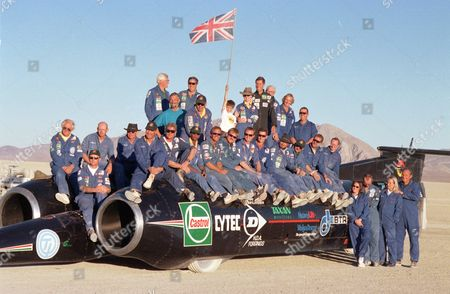 """World Land Speed Record team with Thrust SSC. Black Rock Desert, Nevada, America - 1997. Meredith-Hardy's reputation as a pilot led to him playing a key role in the land speed record attempt by British entrepreneur Richard Noble and driver Andy Green, with their Thrust SSC super-car. The only suitable location in the world to make the attempt with the monster of a machine was the Black Rock Desert, Nevada, which has 20 miles of completely flat and open land. Meredith-Hardy's job was to patrol the 60 mile perimeter to ensure the ground was clear. """"The last thing they wanted was some American in a motor-home tootling across the desert and the Thrust comes along at 700 miles an hour,"""" he laughs. The pilot's role gave him a unique viewpoint on the jaw-dropping spectacle - the Thrust SSC broke through the sound barrier, reaching a speed of 761mph, or one mile every four seconds - a new world record. Recalling the experience, he says: """"We got the sonic boom in the microlight, the car would come tearing past and when it had just passed you'd get BOOM BOOM! By capturing the momentous occasion on camera, Meredith-Hardy came away with the only aerial photographs of the shockwave created by the sonic boom. He explains: """"The ground was incredibly dusty from all the cars driving over it and breaking the crust, and we had a terrific gale the day before, spreading the dust all over the desert, so what the shock wave was doing was picking up all this dust, which was being lit up by the low sun, and that's what you see in the photos."""" So what has been the highlight of his career? """"Well it's obviously nice to win the world championships and things,"""" he modestly replies. """"When I was world champion, at the same time I was British and European champion, and the World Cup winner at the same time which was quite good. There was Africa and Everest, and then there was the Thrust SSC, that was an extraordinary thing to have done."""""""