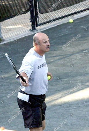 Editorial picture of DR PHILLIP C MCGRAW AKA 'DR PHIL', RESIDENT EXPERT ON HUMAN BEHAVIOUR ON 'THE OPRAH WINFREY SHOW', PLAYING TENNIS AT THE BEL AIR COUNTRY CLUB, CALIFORNIA, AMERICA - 27 JUL 2004