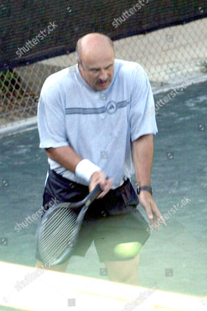 Editorial photo of DR PHILLIP C MCGRAW AKA 'DR PHIL', RESIDENT EXPERT ON HUMAN BEHAVIOUR ON 'THE OPRAH WINFREY SHOW', PLAYING TENNIS AT THE BEL AIR COUNTRY CLUB, CALIFORNIA, AMERICA - 27 JUL 2004
