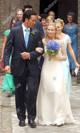 Gary Lewis arm in arm with Lady Davina Windsor outside the chapel