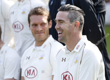 Stock Picture of Kevin Pietersen of Surrey CCC laughs as his talks with team mate Chris Tremlett as they wait for the media day team photo
