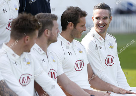 Kevin Pietersen of Surrey CCC laughs as his talks with team mate Chris Tremlett as they wait for the media day team photo