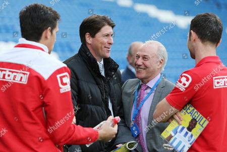 Bournemouth Chairman Jeff Mostyn jokes with former Bournemouth player Darren Anderton.