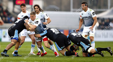 Stock Picture of Gareth Anscombe of Cardiff Blues takes on Jerry Yanuyanutawa of Glasgow Warriors