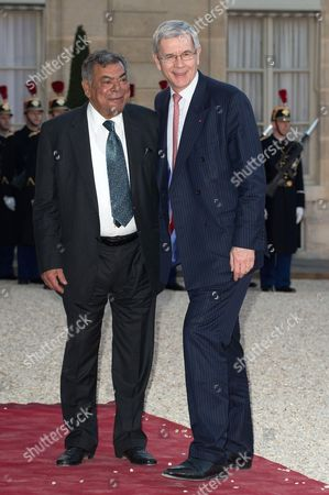 France's nuclear Group Areva Chairman Philippe Varin and guest arrive for an official dinner in honor of the Indian Prime Minister Narendra Modi at the Presidential Elysee palace in Paris