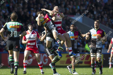 Ollie Lindsay-Hague of Harlequins out-jumps Jonny May of Gloucester