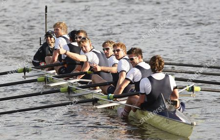 Jamie Cook of Oxford (5th from R) celebrates with team mates winning 2015 Men's Boat Race