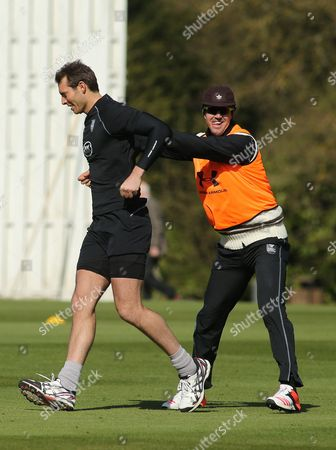Stock Photo of Kevin Pietersen of Surrey jokes with team mate Chris Tremlett during the warm up.