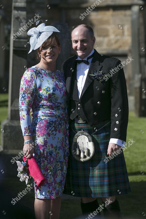 William Murray arrives at cathedral with partner