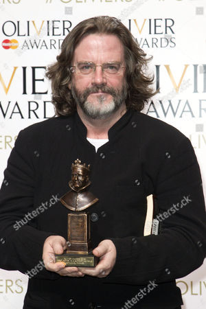 Gregory Doran accepts the award for Best Actor in a Supporting Role for Wolf Hall and Bring Up the Bodies on behalf of Nathaniel Parker