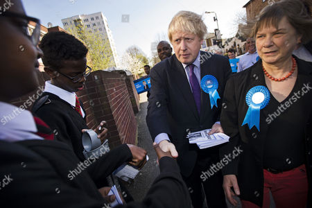 Stock Photo of Mayor of London Boris Johnson meets members of the public while campaigning for the conservative party in Acton, West London with local conservative candidate Angie Bray (not pictured).
