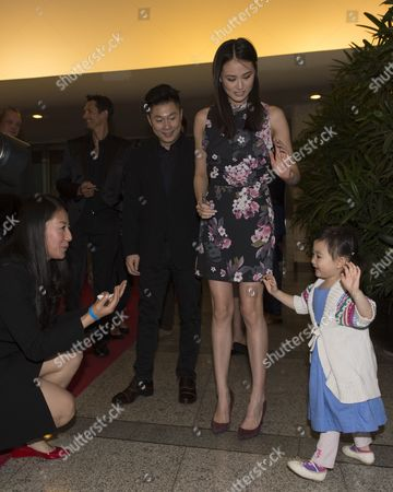 Stock Image of Li Xioapeng with his wife Angel and daughter Olivia, 3