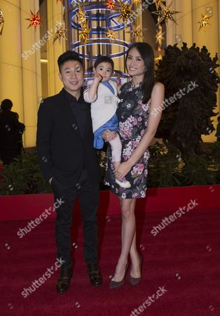 Stock Picture of Li Xioapeng with his wife Angel and daughter Olivia, 3
