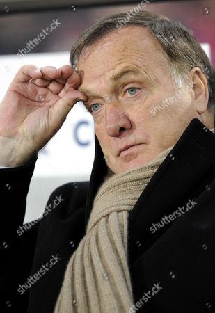 Stock Photo of Dirk Nicolaas Dick ADVOCAAT, coach, Zenit St. Petersburg, picking his eyebrow
