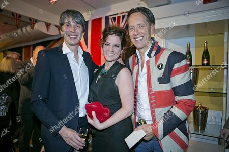 Editorial photo of Professor Brian Cox (left) And His Wife Gia Milinovich With Richard E. Grant. Richard E. Grant Launches His Debut Fragrance 'jack' At Liberty.