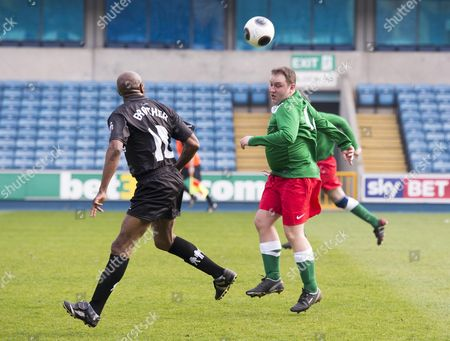 Prostate Cancer Uk Charity Football Match At Millwall Football Club. The Teams Where 'men Utd' Vs Ukpfc . Ian Murray Mp With Luther Blissett.