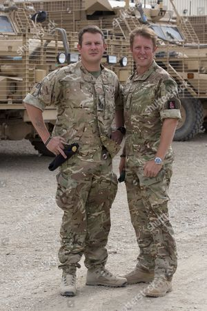 Editorial photo of Bomb Disposal Experts Staff Sergeant Lee Hughes Right And His Younger Brother Warrant Officer Kim Hughes Who Was Awarded The George Cross After An Earlier Tour. See Ian Drury Story.