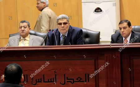 Judges attend the retrial of Gamal and Alaa Mubarak, the sons of former former the President