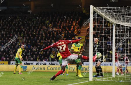 Albert Adomah of Middlesbrough scores the opening goal past Norwich City Goalkeeper John Ruddy, 0-1