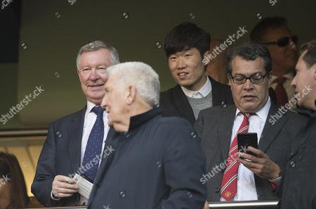 Sir Alex Ferguson attends the match alongside former player Ji Sung Park