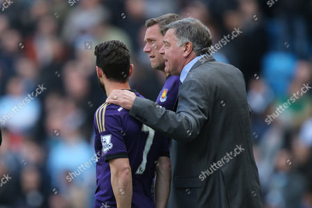 West Ham United Manager Sam Allardyce  with his arms around his two substitutes Matthew Jarvis and Kevin Nolan of West Ham United