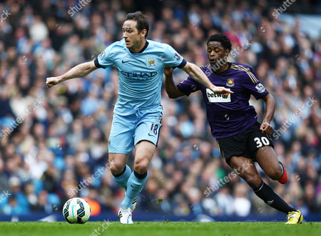Frank Lampard of Manchester City and Alexandre Song of West Ham United