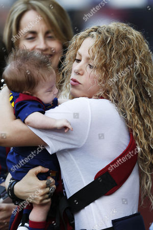 Stock Picture of Shakira holds her son Sasha Pique