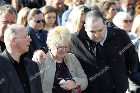 David Craig comforts an Irish woman, he has been accused of being a 'professional mourner', being at the front of several vigils in Glasgow