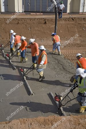 Stock Picture of Workers line a Salt River Project canal with concrete to cut down on water loss; the city's water supply comes largely from canals that bring water from the surrounding mountains and from the Colorado River, Phoenix, Arizona, USA
