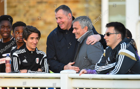 Chelsea manager Jose Mourinho prefers the surroundings of Motspur Park for the Fulham U21 match against FC Porto to the Madrid derby as he greets Fulham goalkeeping coach Vic Bettinelli alongside his son Jose junior