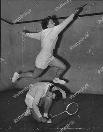 Stock Photo of Miss J. Gidwell Of Sutton Coldfield Leaps Over Miss J. Doe Of Croydon During Their Squash Match.