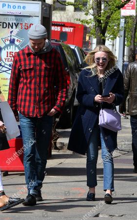 Stock Image of Dakota Fanning and Jamie Strachan