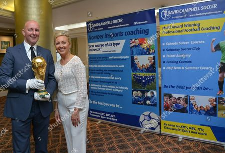 Stock Picture of Former Northern Ireland and Nottinham Forrest footballer David Campbell, and wife Lorraine Sass with the World Cup at the premiere of the film 'Shooting for Socrates'