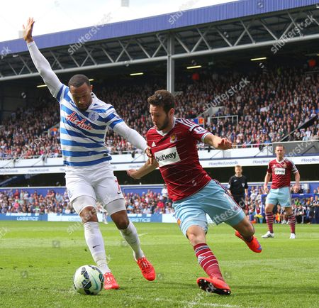 Queens Park Rangers' Matt Phillips and West Ham United's Matthew Jarvis compete for the ball - Photo mandatory by-line: Mitchell Gunn/JMP - Mobile: 07966 386802 - 25/04/2015 - SPORT - Football - London - Loftus Road