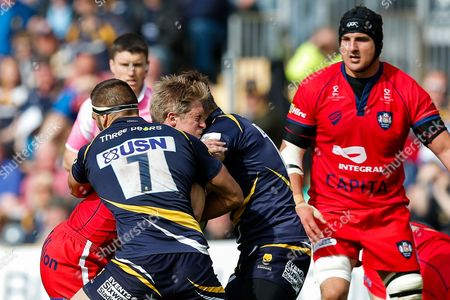 Bristol Rugby Winger Charlie Amesbury is tackled by Worcester Flanker Sam Betty and Inside Centre Ryan Mills