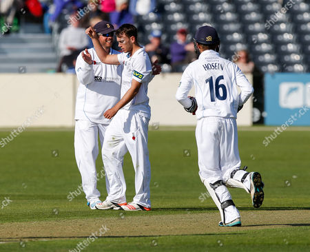 Alex Hughes of Derbyshire celebrates after he bowls out James Hughes of Gloucestershire by L.B.W for 6