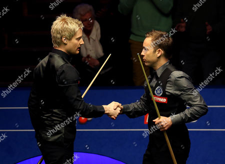 Stock Image of Neil Robertson shakes hands with Allister Carter after winning the 2nd round