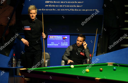 Stock Picture of Neil Robertson and Allister Carter during the 2nd round