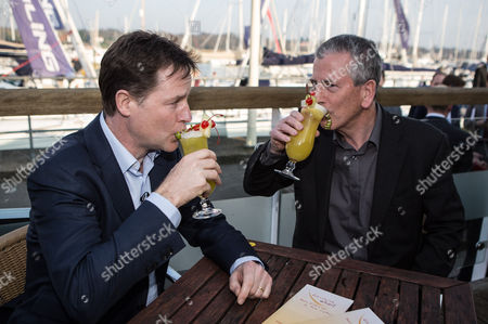 The Deputy Prime Minister and Leader of the Liberal Democrats Nick Clegg with the Lib Dem PPC for Eastleigh Mike Thornton share specially designed cocktails at the Port Hamble Marina.