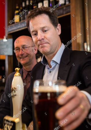 Stock Picture of The Deputy Prime Minister and Leader of the Liberal Democrats Nick Clegg pulls a pint in a pub in Bath during a campaign visit with retiring MP Don Foster and the Lib Dem PPC for Bath Steve Bradley (not pictured)