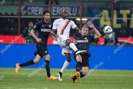 "(L-R) Andrea Ranocchia (Inter), Victor Ibarbo (Roma), Nemanja Vidic (Inter) - Football / Soccer : Italian ""Serie A"" match between Inter Milan 2-1 AS Roma at Stadio Giuseppe Meazza in Milan, Italy."