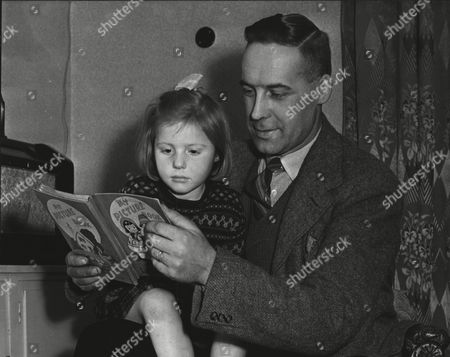Constable Andrew H. Cruickshank Of Glasgow City Police Who Has Been Awarded The B.e.m. Pictured At Home With His Daughter Jean. Box 553.