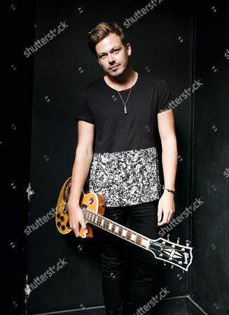 London United Kingdom - July 31: Portrait Of Guitarist Ben Sansom Of English Hard Rock Group Lower Than Atlantis Photographed Before A Live Performance At Dingwalls In London On July 31