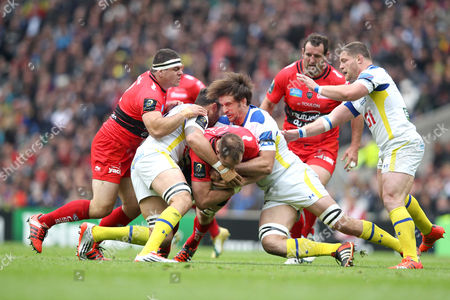 Toulon's Ali Williams is stopped in his tracks by Clermont's Julien Pierre (R) & Clermont's Damien Chouly (Cap) (L) 