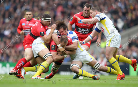 Stock Picture of Toulon's Ali Williams is stopped in his tracks by Clermont's Julien Pierre (R) & Clermont's Damien Chouly (Cap) (L) 