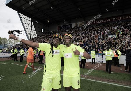 Marlon Harewood of Hartlepool United and Darren Holden of Hartlepool United celebrates with the fans at the end of the game wearing Rasta Hats