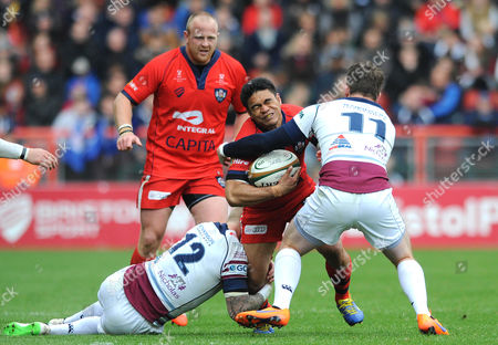 Stock Image of Bristol Winger David Lemi is challenged by Rotherham Inside Centre Jordan Davies and Winger Michael Keating