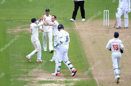 Graham Wagg of Glamorgan celebrates the wicket of Ben Cotton with team mates.