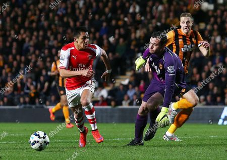 Alexis Sanchez of Arsenal goes around Hull City goalkeeper Steve Harper to score his goal 0-3